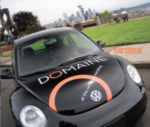 wrapped car add to fine are of real estate marketing